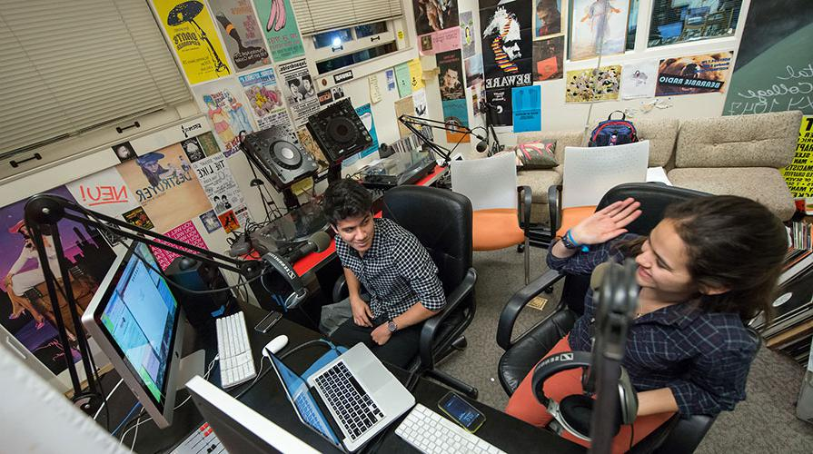 Students in the KOXY student radio studio